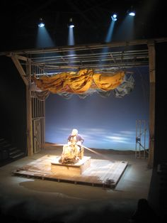 'Our Country's Good' Out-of-Joint/St. James's Theatre, London. Directed by Max Stafford Clark, lighting by Johanna Town. Scene: Rowing