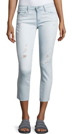 Cropped Distressed Denim Jeans by AG Adriano Goldschmied. AG jeans in light-wash indigo denim with distressing. Five-pocket style; tonal stitching on back pockets. Rise sits b...