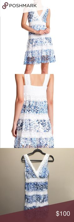 "T Tahari Raya Laser-Cut Lace A Line Dress NWT. Retail $198  - Surplice neck with crochet lace trim - Sleeveless - Smocked back - Crochet lace panels throughout - Cutout overlay detail throughout - Printed allover - Lined - Approx. 38"" length (size S) - Imported Fiber Content Shell/Lining: 100% polyester Care Machine wash cold Additional Info Fit: this style fits true to size. T Tahari Dresses Mini"