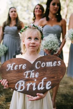 here comes the bride rustic heart sign http://www.weddingchicks.com/2013/09/23/romantic-woodland-wedding/