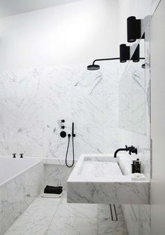 Splendor in the Bath. Marble floating vanity with black bathroom hardware and fixtures.