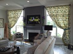 Beautiful window treatments in living room by Draped in Style.