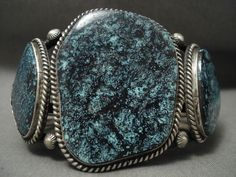 This piece contains three huge blue turquoise stones with very very tight spiderweb matrix. These stones are incredibly collectible and look at the color and matrix, just amazing! Surrounding the stones are imrpessive hand twisted silver ropes and shells. | eBay!