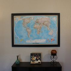 Blue World Travel Map with Pins and Black Frame