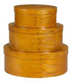 Willis Henry Shaker Auction 9/10/16 Lot 78. Estimate: $1,000 - 2,000. Realized: $840.  Desc:  3 Oval Boxes, Cherry, maple & pine, original orange shellac finish, cherry wood lids, graduated sizes, 4 1/2″, 5 7/8″ & 6 7/8″ l, 2 have 3 fingers, one has 4 fingers, small copper tacks, New Lebanon, NY, c. 1900, (sold WHA, 9/21/96, lot 6; ex. Wadleigh/Wombolt collection).