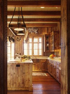 perfect rustic kitchen....loving all that wood.