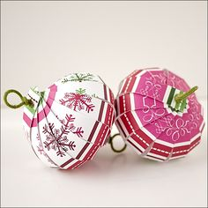Christmas ornaments made from 35 strips of paper and florist wire.