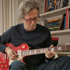 Even your next door friend might be your own guitar role model. Oh, oops, this next door dude is Eric Clapton. (Photo by Rolling Stone)