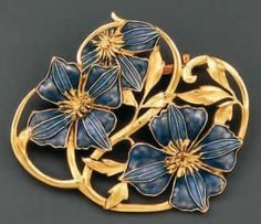 RENÉ LALIQUE. 1901 'Pansies' Brooch. Gold framing supports three pansies in blue and mauve translucent enamel. From rlalique.com