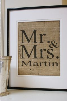 This is a cute idea, printed name and wedding date on burlap and framed..
