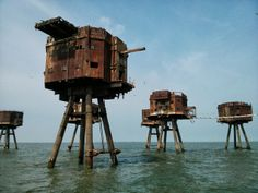 MAUNSELL FORTS England These sci-fi towers were constructed in the Thames estuary to protect Englands coast from German air raids during World War II. After being abandoned in the forts were briefly used to broadcast offshore radio stations. Abandoned Buildings, Abandoned Places In The Uk, Abandoned Train, Abandoned Mansions, Metal Buildings, Places In New York, Places Around The World, Around The Worlds, Maunsell Forts