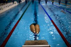Emilio Morenatti–AP  Sept. 1, 2012. Australia's Reagan Wickens jumps into the swimming pool during training before the men's 400 metre Freestyle S6 competition at the 2012 Paralympics Olympics in London.