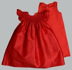 Rose is a Dupioni Silk dress with intricate hand smocked details. This bishop dress with butterfly sleeves is sure to be adorable on every little girl! Includes matching slip for maximum comfort. Red Flower Girl Dresses, Little Girl Dresses, Girls Dresses, Southern Dresses, Toddler Christmas Dress, Red Christmas Dress, Girls Christmas Dresses, Toddler Girl Outfits, Toddler Girls