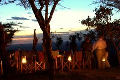 Sun-downers followed by dinner in the bush overlooking the starlit Serengeti National Park at Buffalo Luxury Camp. Get Closer. Be Closer. #IntimatePlaces #Tanzania #BuffaloLuxuryCamp #Bush #Dinner #Sundowners #View #Evening #UltimateSafariExperience  www.intimate-places.com Serengeti National Park, Private Games, Luxury Camping, Tanzania, Closer, Buffalo, Safari, Tourism, National Parks