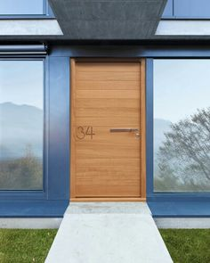 , Contemporary Light Brown Urban Front Doors Made By Wooden With Modern Door Handle Design Also Modern Windows Design Also Slate Gray Wall Color: Exterior Urban Front Doors and Garden Contemporary Front Doors, Modern Front Door, Exterior Cladding, Exterior Doors, Front Door Handles, Villa, Glass Front Door, Outdoor Doors, Entrance Doors