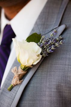 This country chic boutonniere features a white lisianthus and lavenders.