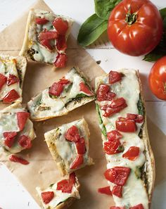 Tuscany Bread::basil pesto, baby spinach, melted cheese, and seasoned tomatoes