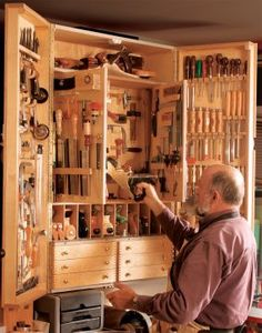 Tool Cabinet plans~Jan Zoltowski didn't build his tool cabinet until he'd been woodworking for 35 years. The results were clearly worth the wait.  His wall-hung cabinet holds more than 300 hand tools while taking up only about 12 square feet of wall space. The design is an ingenious combination of interior doors and drawers, along with multiple divided storage compartments