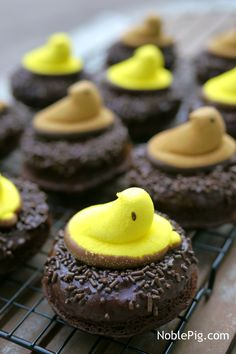 Peeps Chocolate Donut Nests from NoblePig.com. These doughnuts are perfect for the Easter table. What could be cuter and better than a homemade breakfast everyone will love.