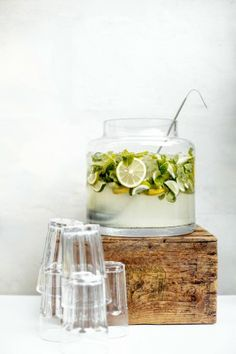 Gin Punch: 2 lemons 2 limes 1/2 cup superfine sugar 1 cup freshly squeezed lemon juice, strained 1 750 mL bottle of gin 4 oz maraschino liqueur mint soda water