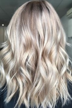 """This color """"Champagne Bronde,"""" is everything! We've heard the term bronde (that middle ground between brown and blonde), and champagne bronde is its cool sister. Think of it as a lived-in platinum blonde."""