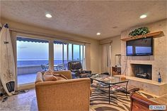 The living room with its big sliding doors leading right to the beach