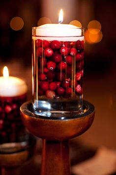 Cranberry-Floating-Candle-Centerpiece | photography by http://beckyhillweddings.com/