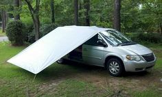 Minivan Awning- tarp to bungee cord to tent stake, other end to top of minivan OR caribeneered to another one over the other side and to the ground in the same fashion
