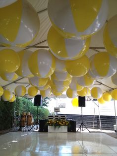 fun summer party decor-I'm not sure that they are filled with helium, as I'm not sure that they would stay afloat, but we could string them from their tabs if we like it and can do it cheaply.
