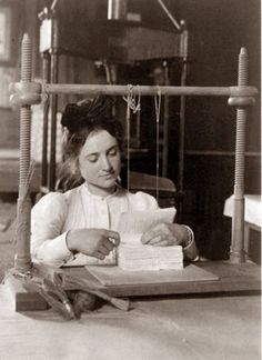 This picture was taken in 1900 and shows a young woman working as a Book Binder.
