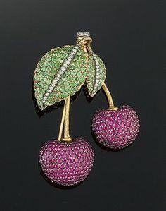 A ruby, green garnet, diamond and enamel brooch
