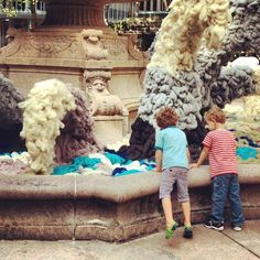 Kids playing by the wool fountain in Bryant Park