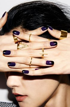 rich purple nails + gold jewelry