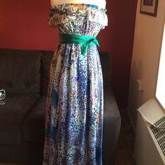 Multi Colored Silk Maxi Dress with Sash Beautiful maxi dress in fun Multi print design with a green silk sash. Blue silk lining. No wear or tear or stains on dress. Worn 1x for a wedding with gold sandals. A statement piece for sure. Boutique Dresses Maxi