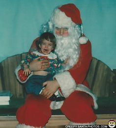 """Kimberly says: """"This is a picture of me when I was a one year old (1978). I think the Santa was having a rough day. Either that, or he wanted to kill me. Or both."""""""