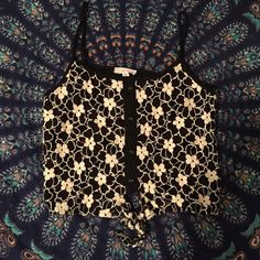 Floral Lace Tie Up Crop Top Floral lace design tie up crop top✨ Super cute, has a vintage feel✨ Worn 2 times, perfect condition✨ Can fit a small/medium✨ Mine Tops Crop Tops