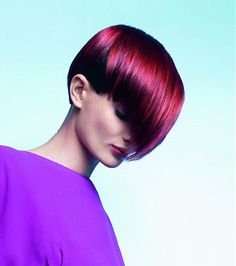 A short red straight coloured multi-tonal  smooth hairstyle by Indola