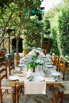 Photography by Yvette Roman. Event Design & Planning by Sterling Social. Venue: San Ysidro Ranch. Floral, Decor & Furnishings by R Jack Balthazar. Outdoor Entertaining. Event Seating. Rustic Outdoor Dinner. Rustic Rehearsal Dinner. Rustic Tablescape.