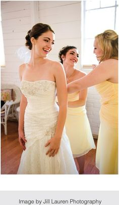 The bride has a laugh with her ladies in waiting as she gets ready for her big moment. Love these short yellow bridesmaids dresses! | WedAZ.com | Wedding Articles