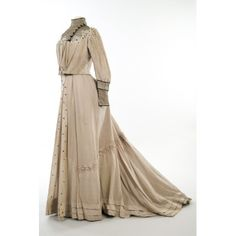 Half-mourning wedding dress, ca. 1905. Gray silk and muslin; 2 pieces. Boned bodice with pouched front, high neck, and long, tight sleeves, and full skirt that is gathered in the back.