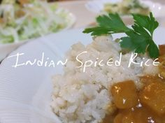 Indian Spiced Rice from Food.com:   An Indian meal is not complete without rice to soak up some of the liquids of the other Indian dishes that is piled on and around it.