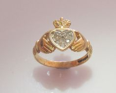This is a vintage 9ct gold Claddagh ring which has six diamonds set into the heart.  It is a UK size K 1/2 USA size 5 3/8  Weight 2.1 grams,