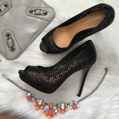 Badgley Mischka black peep toe pump Gorgeous laser cut floral design makes the shoe perfect for any season. Great with summer dresses or with pant suits for work. Leather. Offers welcome through offer tab. No trades. 147161451 Badgley Mischka Shoes Heels