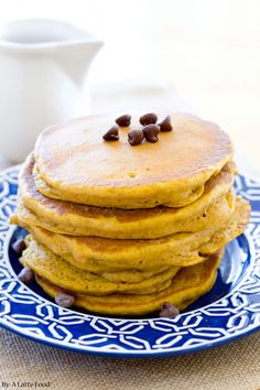 These are the BEST pumpkin chocolate chip pancakes ever! Packed with pumpkin, cinnamon, and chocolate chips!
