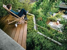 Architect Mary Barensfeld designed this steeply sloping rear garden for a young family in the Berkeley Hills. The confident, tectonic design is composed of an ipe deck next to the house; a patch of white-granite patio stone, cut to match the boards of the deck; a slender, trapezoidal reflecting pool between the two; and a terraced hillside. Photo by Joe Fletcher . This originally appeared in Japanese-Inspired Landscape Design in Berkeley.