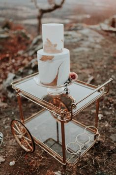 White and rose gold marble wedding cake | Image by Andy Roberts Photography