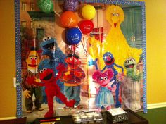 """Sesame Street B_day Photo backdrop @ Party City, Balloons """"taped"""" to it to make it look like they were held by the characters. Bulletin Board border from Walmart: Back to School Sale!"""