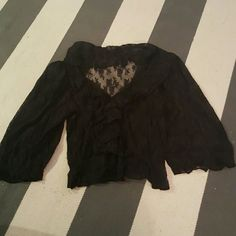 Black lace top Fits s/m Ruffles down front Loose elastic on left sleeve Tops Blouses