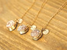 Rose gold druzy necklaces with an initial pendant for bridesmaids.  Cute gift idea!