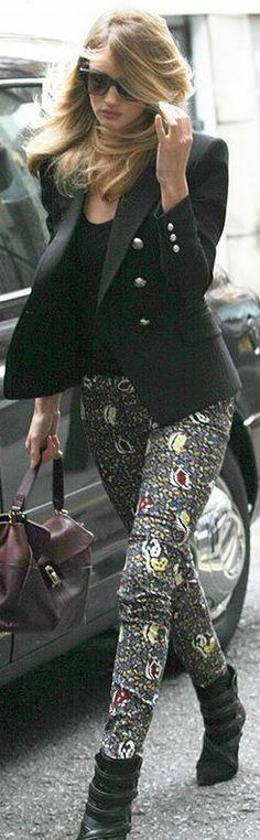 Who made  Rosie Huntington-Whiteley's red handbag, black blazer, print skinny pants, and sunglasses?